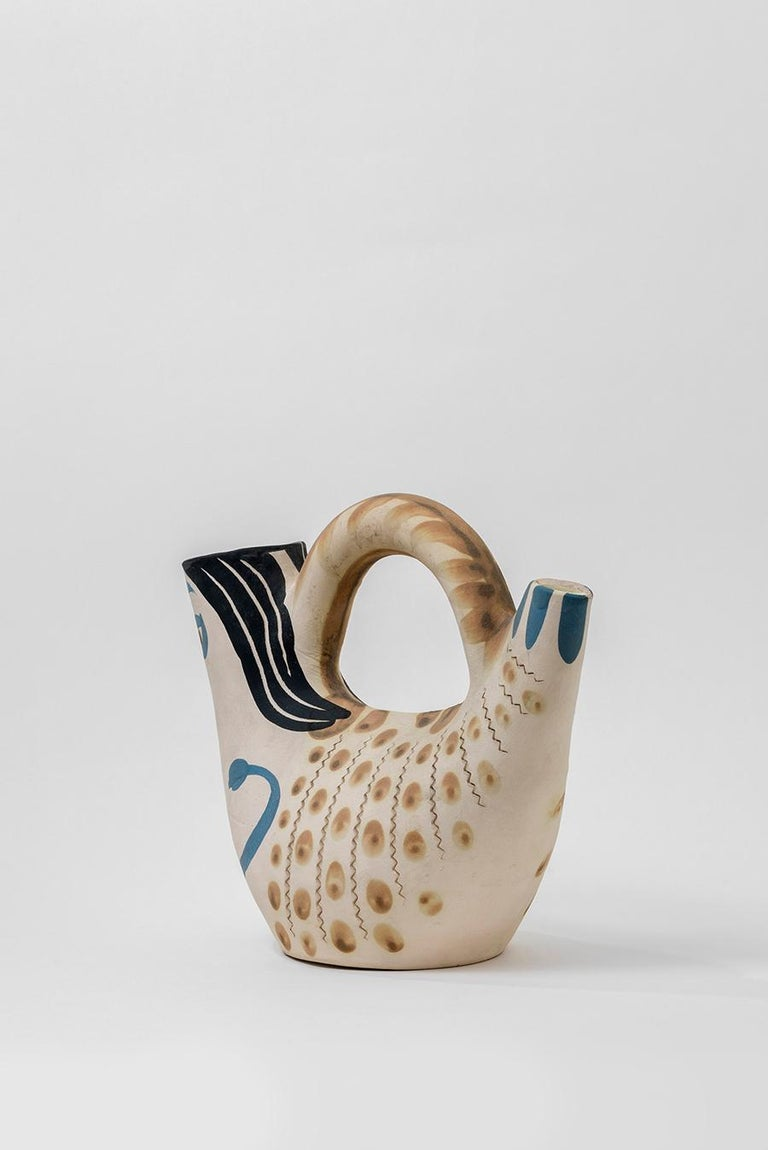 Turned vase (A.R. 136) Numbered 143/500 and stamped 'Madoura Plein Feu / Edition Picasso' on base White earthenware clay, decoration in engobes, partially engraved, and glazed Blue, black, beige Length: 10 inches Executed in an edition of 300  With