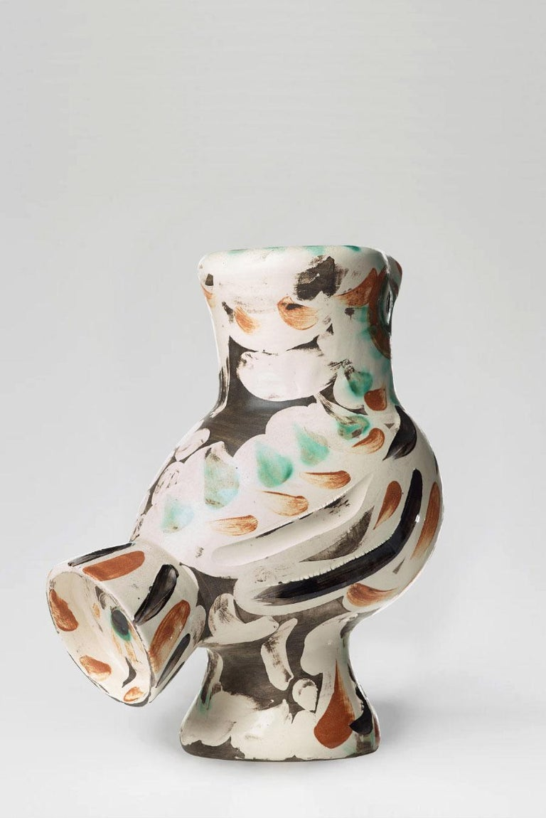 Turned vase (A.R.602) Numbered and stamped 'Madoura Plain Feu / Edition Picasso' on base White earthenware clay, decoration in engobes, engraved under partial brushed glaze Green, black, red, white Height: 32 cm Executed in a numbered edition of
