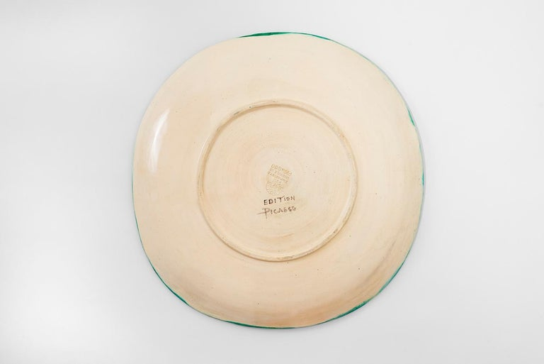 Ceramic dish (A.R. 151) Inscribed 'Edition Picasso' and stamped with 'Empreinte Originale de Picasso / Madoura Plein feu' stamps on reverse White earthenware clay, decoration in engobes under partial brushed glaze, patinated ground Ivory, blue,