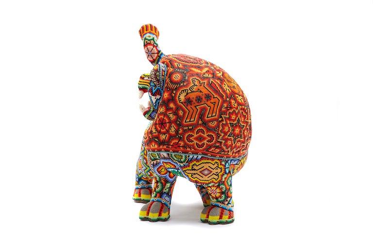 Leon - Lion - Hand Beaded - Mexican Huichol Art - Mexican Folk Art  - Brown Figurative Sculpture by Sergio Bautista de la Cruz