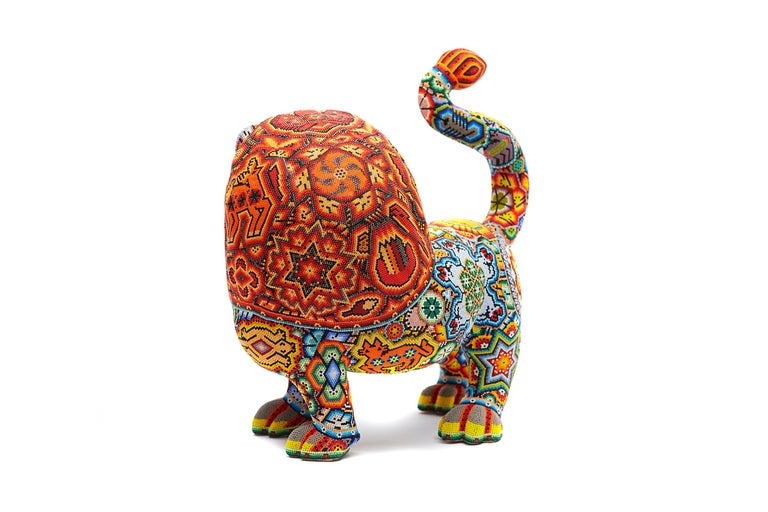 Huichol Indian -  Hand beaded Sea Cow This beautiful Huichol Sculpture beaded has such beautiful bright colors. Hand beaded sculpture with attention to detail. At Cactus Fine Art, we offer an exclusive selection of handmade items from Mexico and