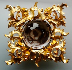 Outside–Inside, Renaissance style, gold carved wood, reclaimed rusted enamel pot