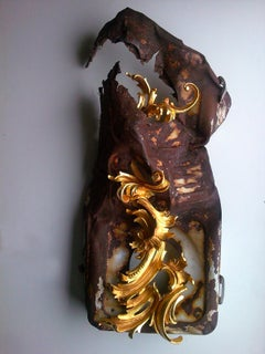 Convivenza, Renaissance style, gold carved wood, reclaimed rusted metal object