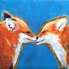 Red Foxes Sharing A Moment