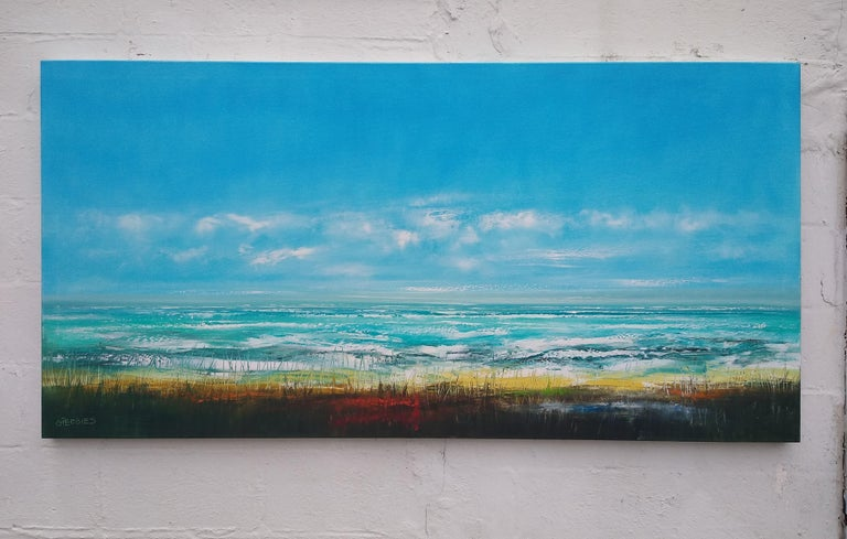 <p>Artist Comments<br />The sweeping blue sky delicately blends with the jewel turquoise waters in this panoramic beach view by artist George Peebles. With the waves crashing together and the grasses swaying in the foreground, one can easily imagine