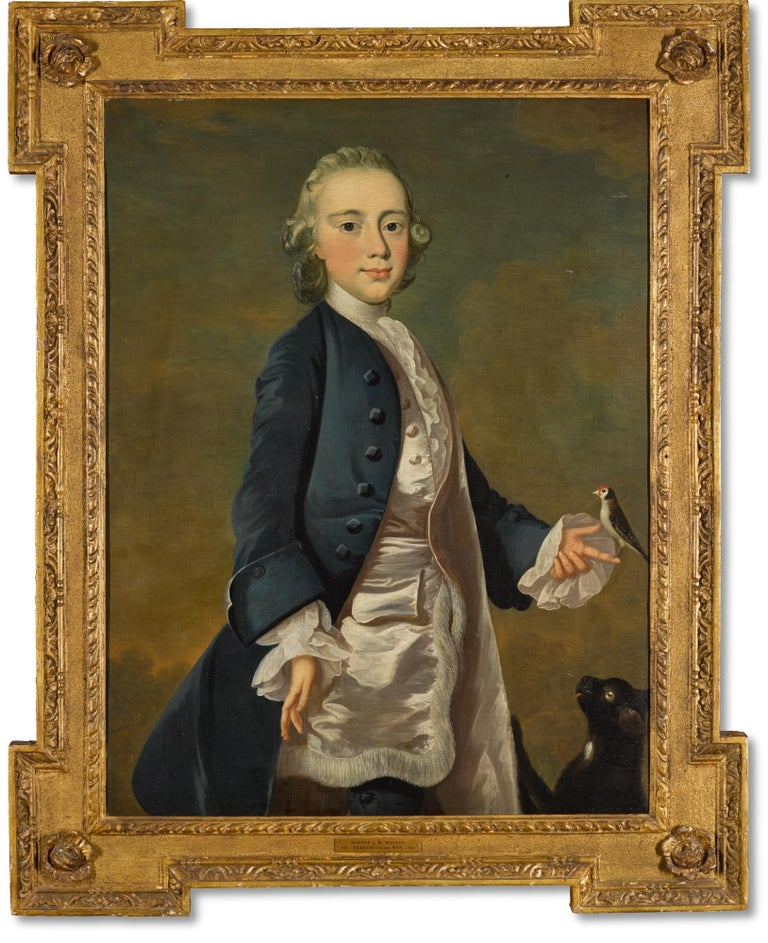 Portrait of Master JW Wanley, three-quarter length, wearing a pink silk waistcoat with tassel trim, holding a bullfinch with his pet cat at his side. Oil on canvas in a period giltwood frame. c.1715  Provenance By descent from the sitter by