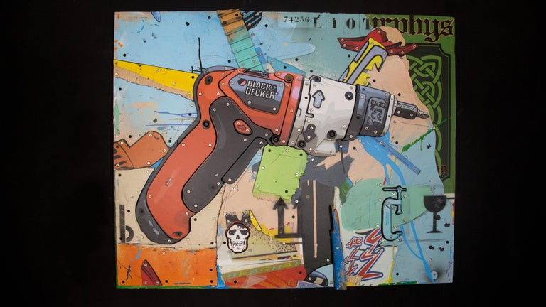 """"""" Black & Decker"""" is a decorated wood sculpture.   It is created by the French artist Maestro Eric Liot.  About the artwork:  TECHNIQUE: Mixte, Low reliefs,  wood assemblage, collage, various objects, acrylic painting   NEW MOVEMENT & STYLE: POP"""
