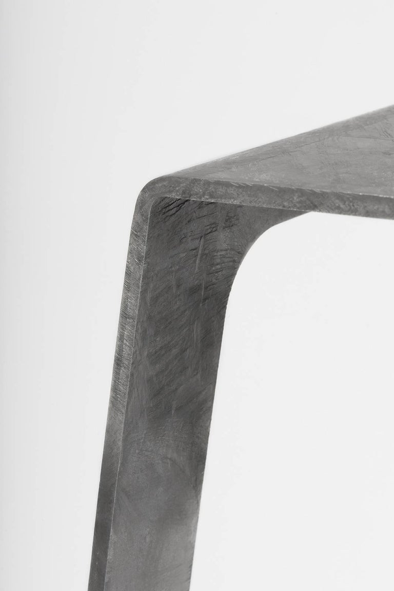 A_Stool bar height stool in hot-dipped galvanized steel. A minimal, backless design in steel with a durable coating of zinc. Also available in brushed, sanded, or polished finish. Signed, dated and numbered to the underside with a laser-etched
