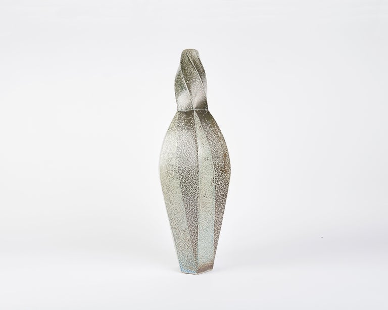 This twisted, faceted vase by contemporary Danish ceramicist Aage Birck, possesses a rigidity and texture unique for the medium.