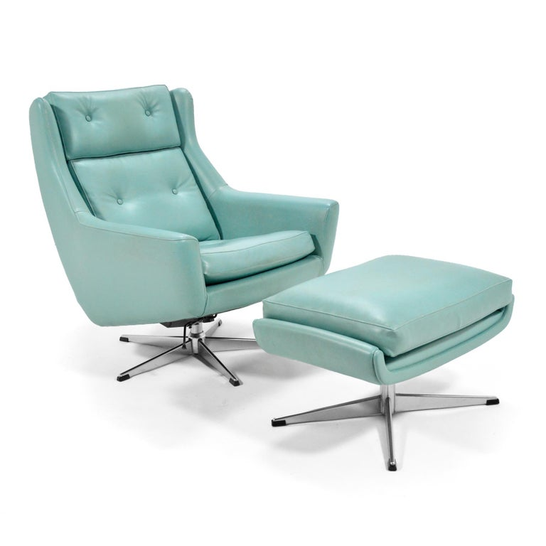 This supremely comfortable lounge chair features swivel function and two positions of locking recline. Designed by Aage Christiansen for Erhardsen & Andersen Denmark, it retains its original faux leather.