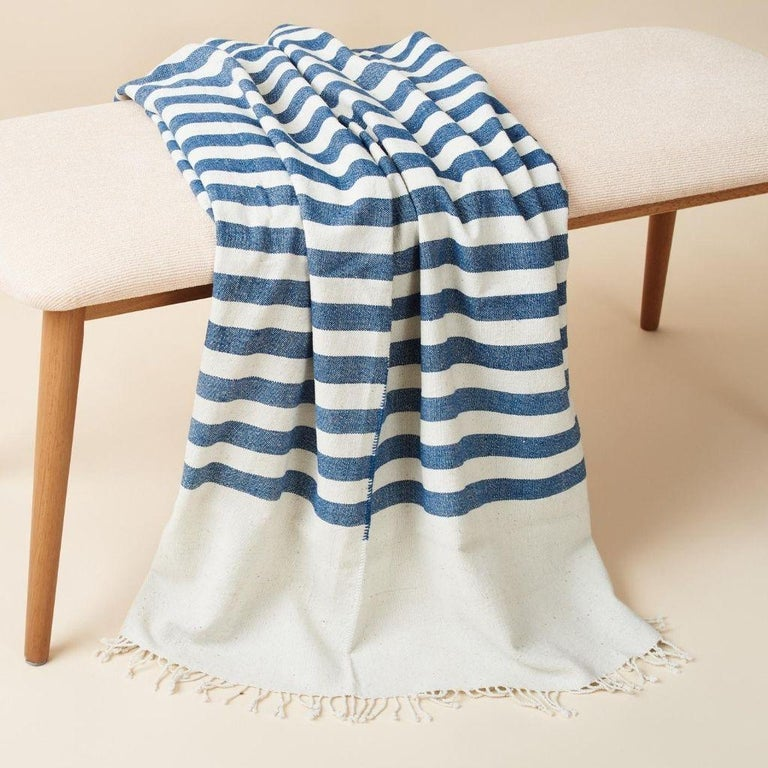 Custom design by Studio Variously, AARI Throw / blanket is handwoven by heritage weaver community in India and dyed entirely with earth-friendly dyes developed locally to artisan cluster.  A sustainable design brand based out of Michigan, Studio