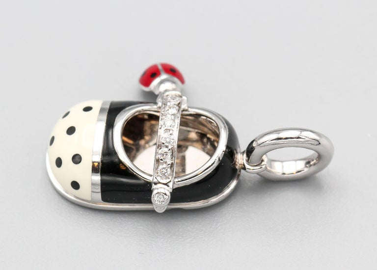 Fine diamond with polka dot enamel and 18K white gold baby girl shoe charm by Aaron Basha. Features high grade round brilliant cut diamonds by the strap of the shoe along with a small attached ladybug charm.  Hallmarks: Aaron Basha,  750, Italian