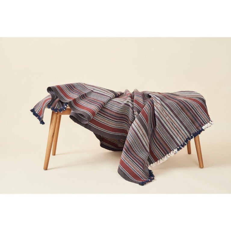 Custom design by Studio Variously, Aasana throw / blanket is handwoven by master weavers in India and dyed entirely with earth-friendly dyes by a small artisan cluster.  A sustainable design brand based out of Michigan, Studio Variously