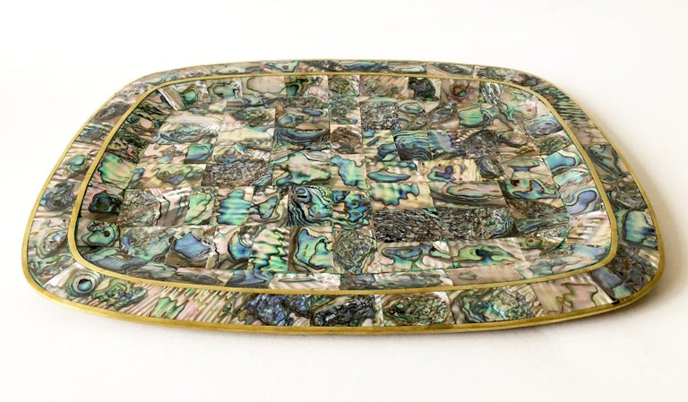 Inlaid abalone and brass tray, circa 1950s - 1960s. Tray measures 10.25