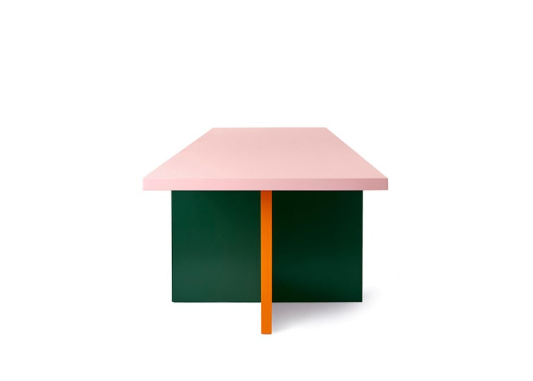 Abbondio is a modern dining and conference table by German designer Moritz Bannach. Its defining characteristic is two sets of crossed table legs carrying an impressive table top. Abbondio features a strong sculptural character and custom colors