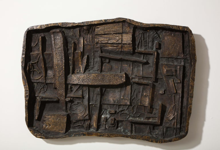 Unique abstract cast bronze wall sculpture by Chicago artist Abbott Pattison (1916-1999). After receiving his B.F.A. from Yale in 1939, and a stint in the Navy, Pattison returned to his native Chicago. From the 1950s through the 1970s, he traveled
