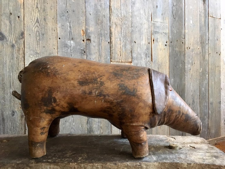 Abercrombie & Fitch vintage leather footstool in the shape of a pig. This footstool is made in the 1960s and the design is by Dimitri Omersa. A special collector's item. The leather shows traces of aging, such as discoloration and small cracks, but