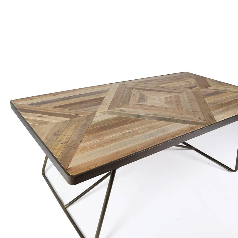 Combining slats of antique reclaimed fir wood positioned to create diamond shapes over a background of parallel lines, the top of this table is a striking decorative piece that resembles inlay work, alternating dark- and light- colored elements for