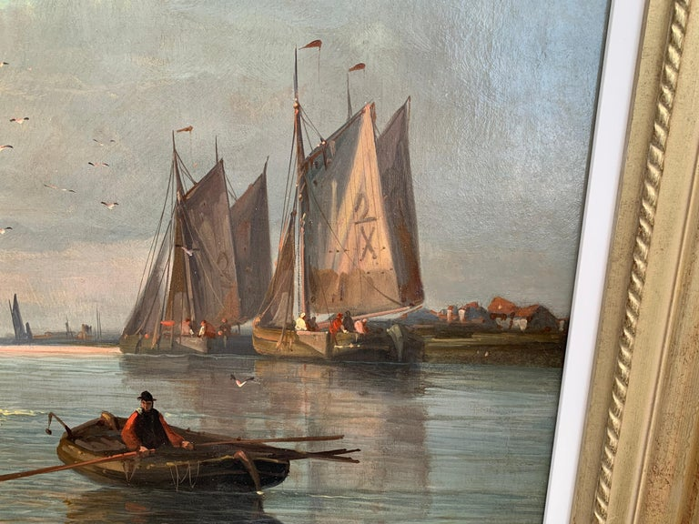 19th Century English or Dutch fishing boats at calm, with a landscape and sunset.  This Fine Oil on Canvas Painting depicts a typical theme in the painter's oeuvre. The Anglo-Dutch artist is renowned for his seascapes showing a strong influence of
