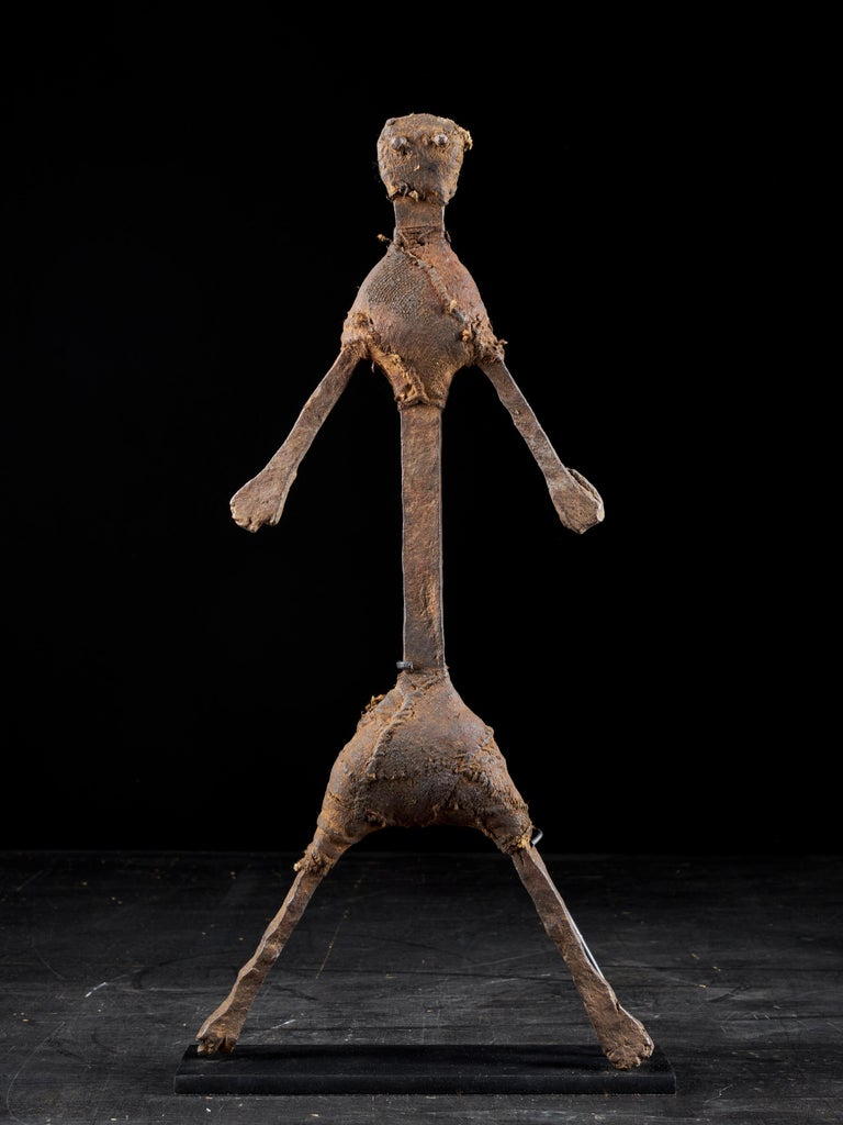 These slender male and female statues were made by the Bozo People from Mali. Their body's, arms and feet are made of thin iron bars and their heads, chests and trunk are covered with leather straps that hold the whole body together. Both figures