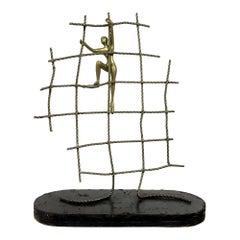 Abstract Brass Figure Climbing a Net Scuplture