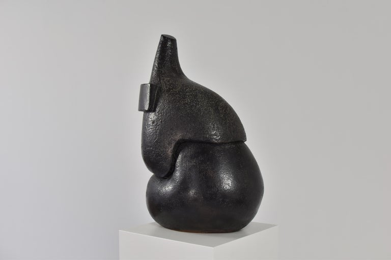 Stunning abstract ceramic sculpture from Belgium, 1950s. The asymmetric shape creates an interesting outline which changes according to the point of view. Very good original condition with surface wear in line with age and use, including very small