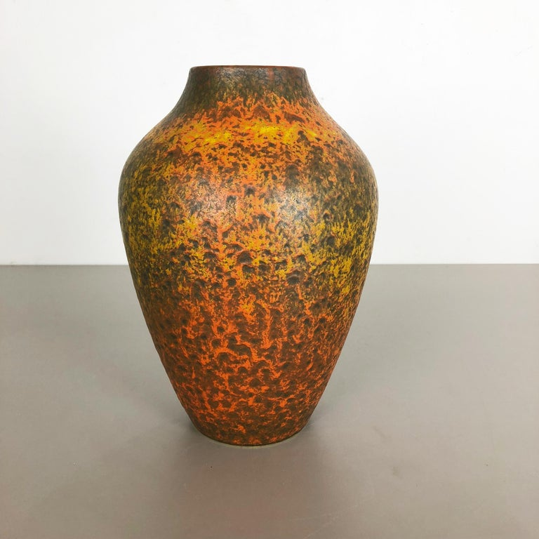 Article:  Pottery ceramic vase   Producer:  Silberdistel Ceramic, W. Germany   Decade:  1950s      Original vintage 1950s pottery ceramic vase made in Germany. High quality German production with a nice abstract illustration and