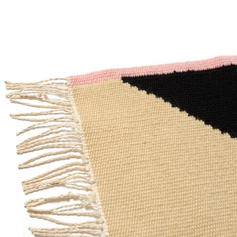 A hand loomed weaving with an abstracted geometric pattern. Based on Aalto's scroll chair. Signed by Artist.