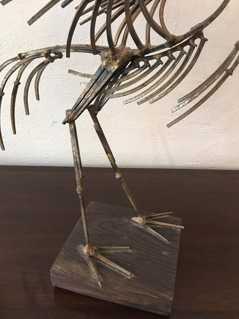Entirely made of nails! Modern abstract bird with it's wings spread. Mounted on wood base.