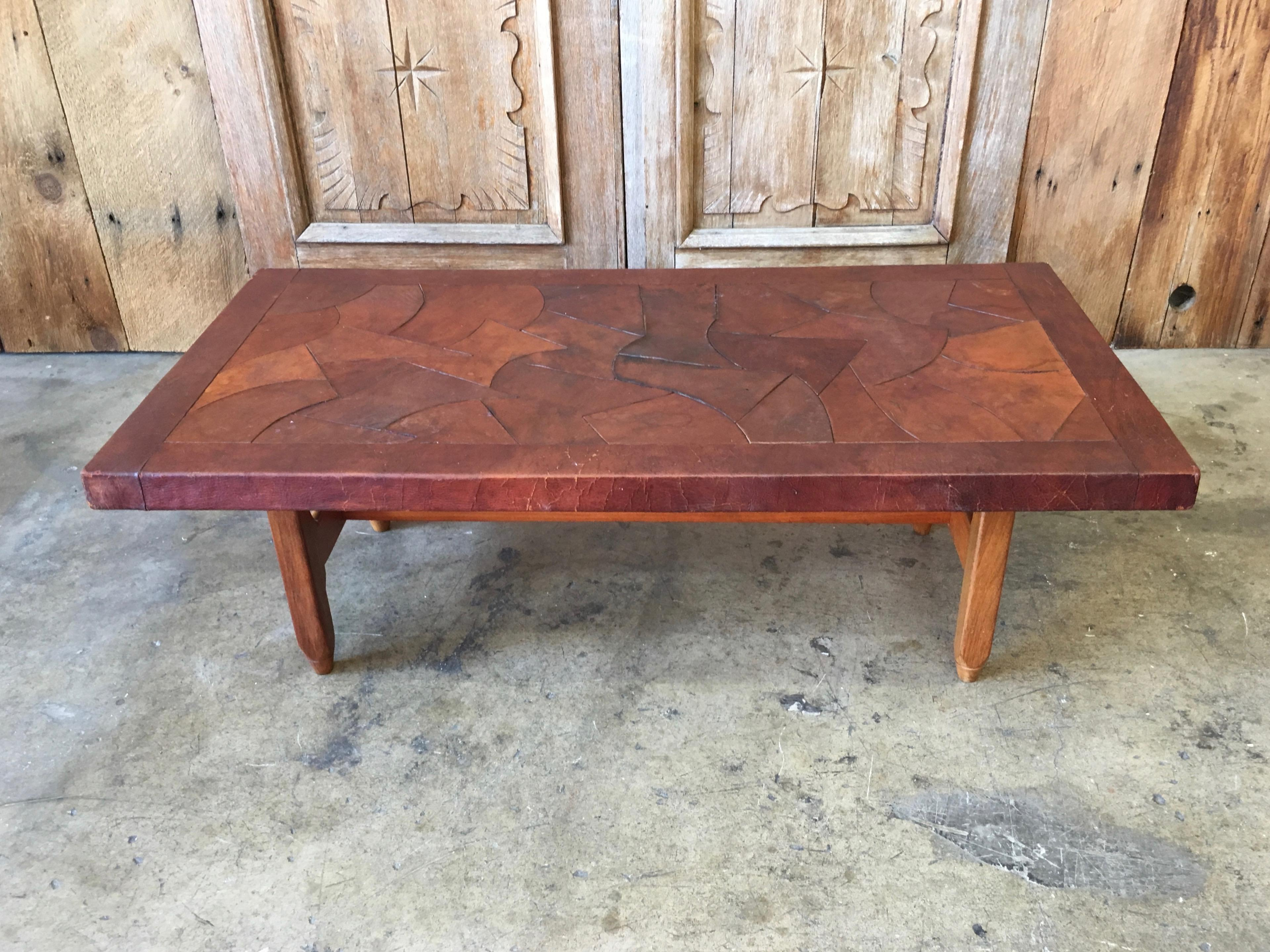 - Abstract Leather Top Coffee Table By