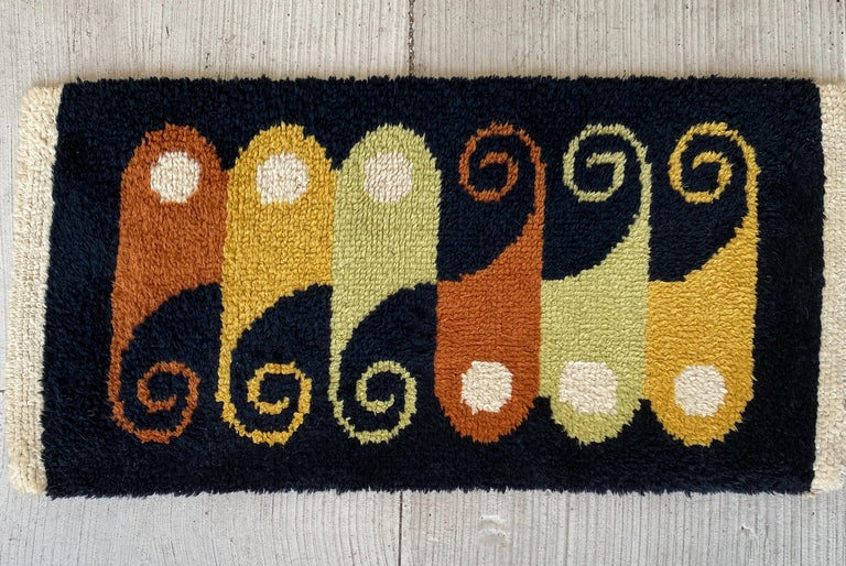 Hand knotted, small-scale wool rug with multi-color abstract pattern, circa 1960s, in the manner of Evelyn Ackerman for ERA Industries.
