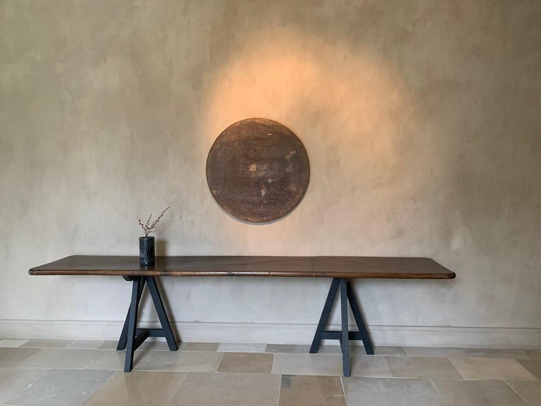 A reclaimed 19th century wine tabletop with a beautiful original canvas top. Displayed as a painting its a example of art made by time.