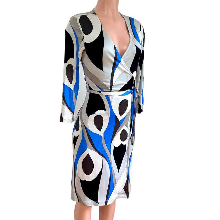 True wrap dress in abstract black, gray and blue feather print on buttery silk jersey. Authentic FLORA KUNG silk dresses are made in premiere quality, long-filament silk yarn which gives a natural simmering glow and a buttery, luxurious feel.  US 4