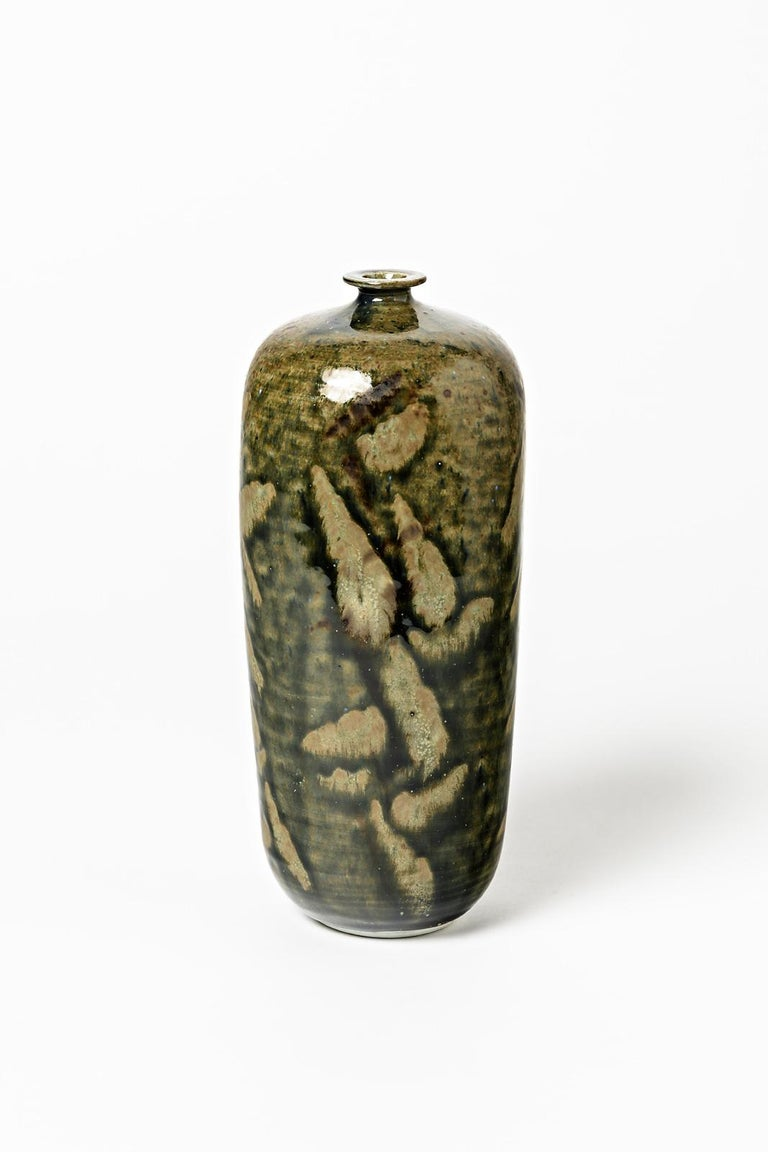 Robert Héraud and Annie Maume  Realised in La Borne circa 1970  Elegant porcelain ceramic bottle with abstract brown and green ceramic glazes colors.  Original perfect conditions  Signed under the base  Measures: Height 23cm, large 9cm.