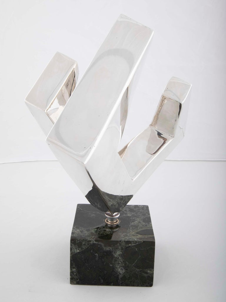 A silver plated abstract sculpture by Lucile Driskell (1924-2017) signed and numbered 1/100.
