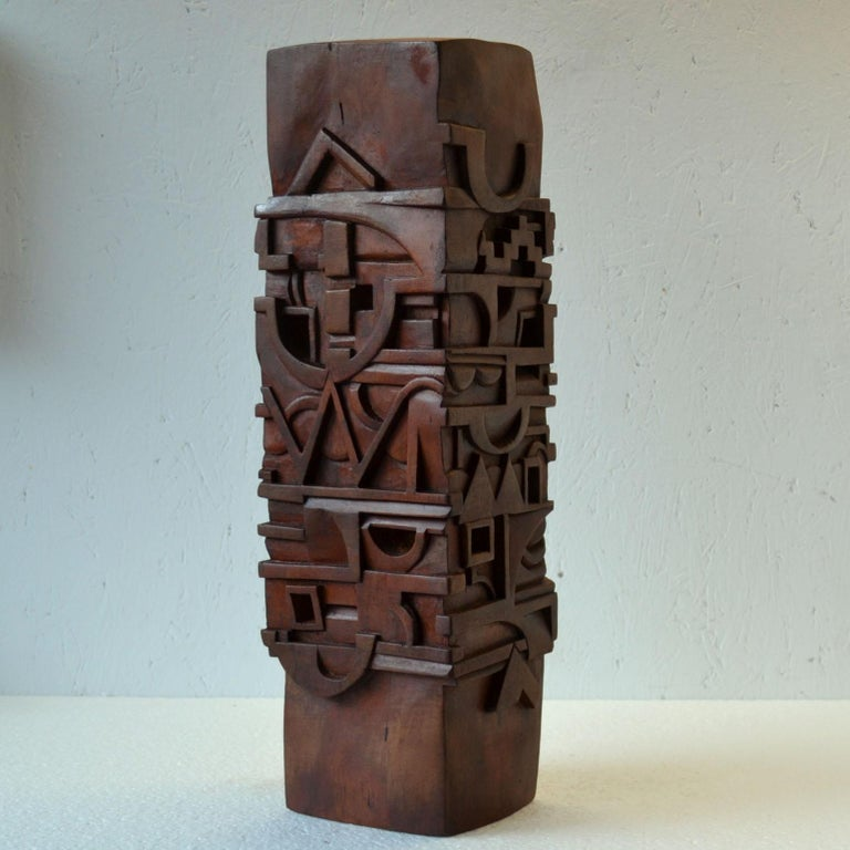 Rectangular abstract totem sculpture carved with letters and symbols and stained in red-brown hard wood, by T. Sabri, France 1987. The Totem is a tower that communicates through a visual language of symbols, pictures, objects, letters and words.