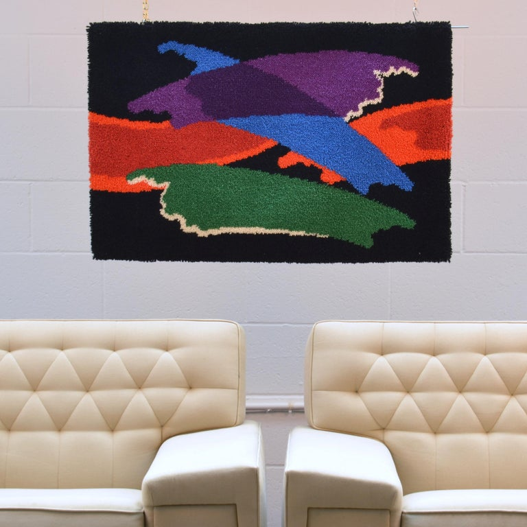 Colorful hand knotted wool hanging is probably a translation of the work of an artist. This was a time when modern artists work began to work with weavers who would translate their paintings into a tufted canvas. The resurgence of tapestries in the