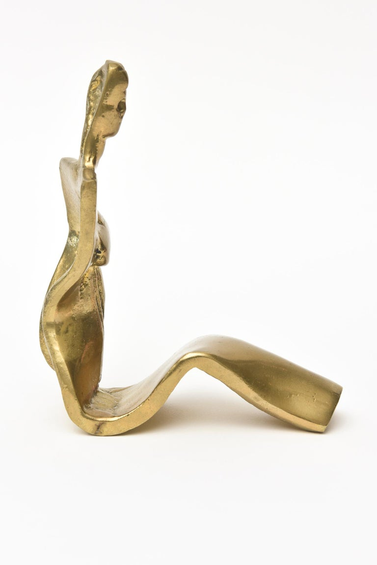 This lovely brass vintage limited edition brass abstract sculpture of a seated woman is signed but not legible and it is numbered 21 /100.