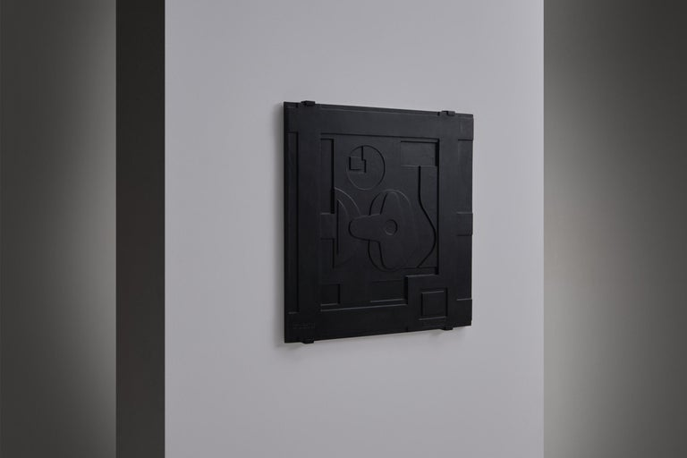 Stunning abstract wall relief, France, 1960's. The artwork is made from cast iron with beautiful abstract shapes reminiscent of the drawings of Le Corbusier. Stamped with: Monnaie de Paris, number 2/50 Signed by the artist 'Benoit'. The work comes
