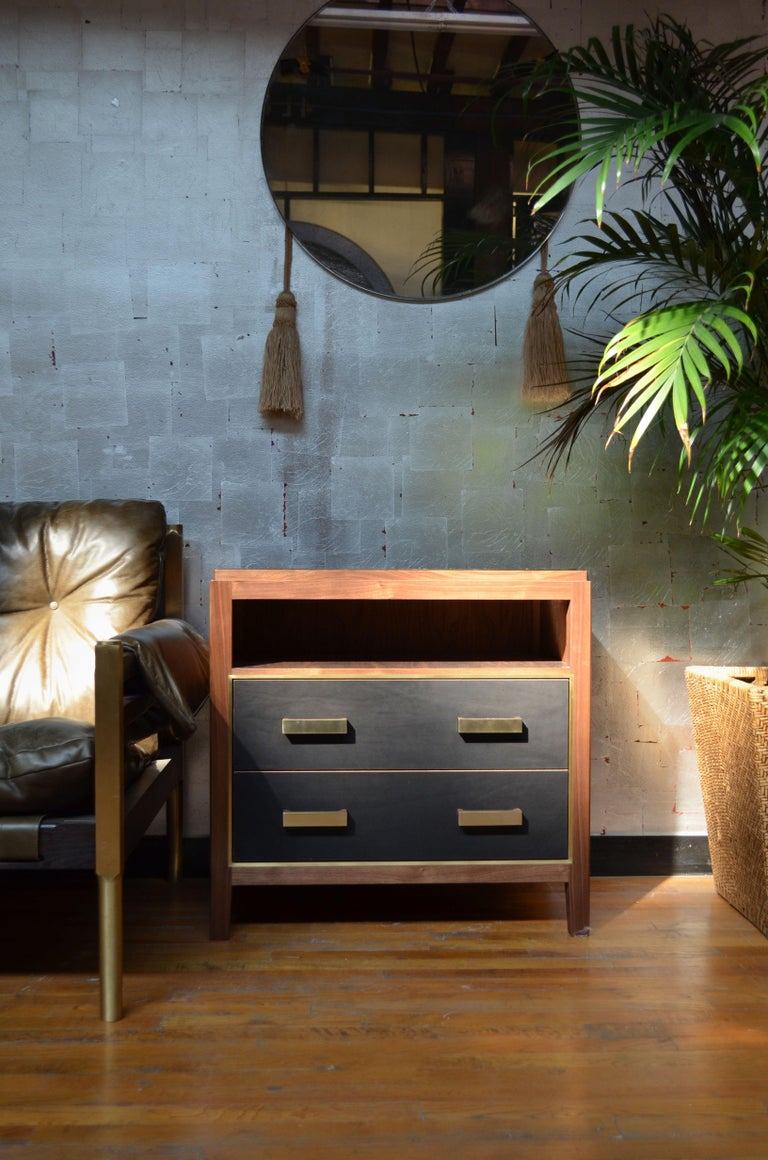 Crafted from rugged saddle leather, the Abuelo collection imitates the streamlined lines of a midcentury piece, while the luxuriousness and richness of its materials create a look all it's own. Solid walnut-construction houses the brass framing of