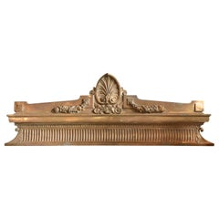 Acanthus Filled Cartouche Set Atop a Decorative Cast Brass Pediment