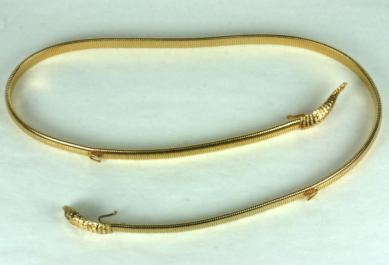 Timeless Gilt Stretch Snake Belt by Accessocraft NY from the 1980's. Snake head and tail motifs on an expandable stretch gilt band which is .5