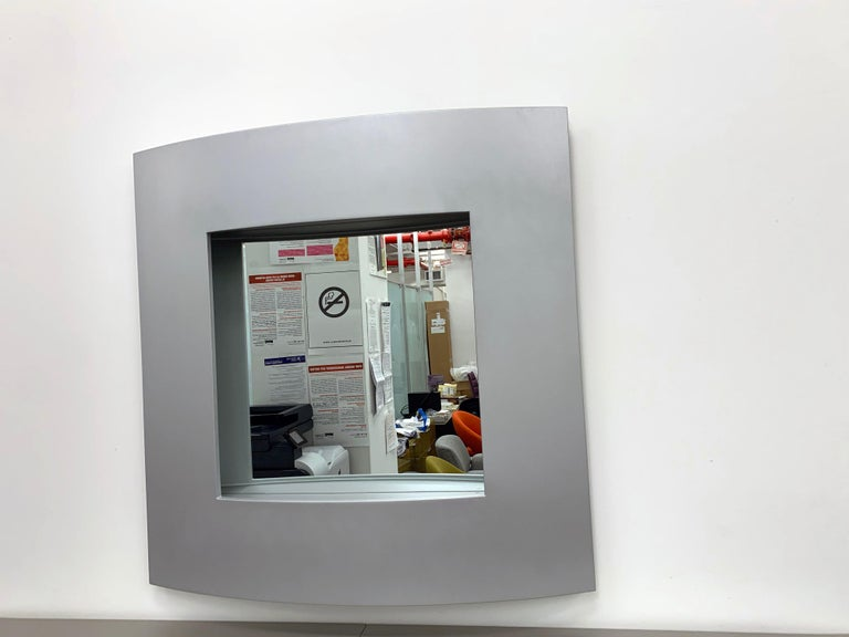 Acerbis wall mirror  Curved wall-mounted Polyurethane Bobilla shelves by Enrico Baleri designed for Baleri Italia in 1996. Wall-mounted polyurethane shelving from Enrico Baleri, a curved, but very angled shape. Shelf dimensions: D 10