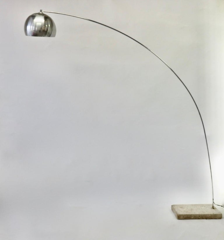 Attributed to Achille and Pierre Castiglioni Arco lamp. Arcing chrome shaft hold aluminum ball globe anchored in steel covered cast cement. Shown here with cement and covered base. Base measures 19 deep - 11.5 wide - 2.5 tall. Lamp is 82 high at
