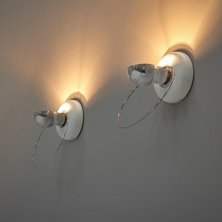 Achille Castiglioni for Flos, wall lamps model 'Bi Bip', ceramic, steel, Italy, 1977  Delicate wall lights designed by Achille Castiglioni in 1977. The forms but also the materials make this lamp special in its expression. From a round base in