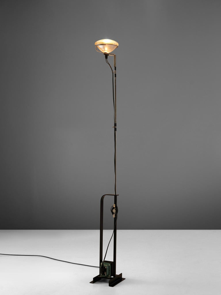Achille et Pier Castiglioni for FLOS, 'Toio' floor lamp, metal and chrome, Italy, 1962.  A floor lamp that encompasses Castiglioni's idea of a ready-made concept. A car headlight is used as lamphead. The foot consists of a transformer, which gives
