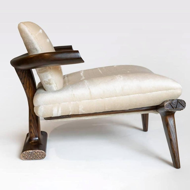 Amboseli, the latest in a series of extraordinary lounge chairs by Roman architect and designer Achille Salvagni, is a piece of superior proportions. Its plush seat and back are supported by a simple structure of supple walnut lines capped at their