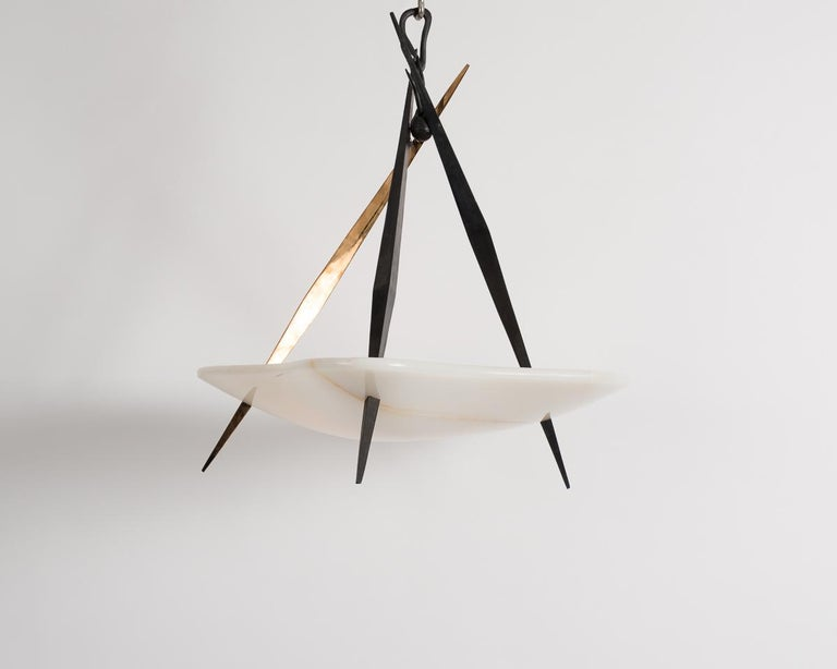 Customizable in size, darts is an arresting chandelier by Italian designer Achille Salvagni that pits the sharp, clean aesthetic of manufactured objects against the cool beauty of naturally occurring substances.