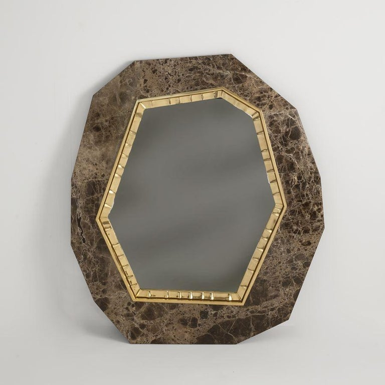 Lucy is a hexagonal mirror set, like a jewel, in a facetted plaque (either of noir doré marble, brown Emperador marble, or polished Royal Oak), and bordered by thin ornamental patinated bronze trim.  Edition of 20. Stamped: Achille Salvagni