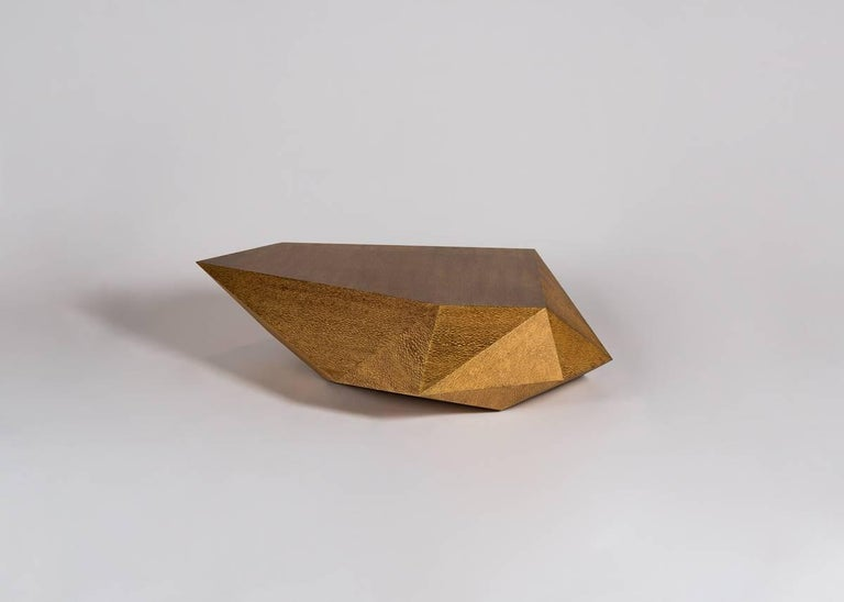 """Pietra, which means """"rock"""" in Italian, is a table of polished lacewood, has the appearance of a naturally occurring angular geological formation. Designed by Rome based architect Achille Salvagni, recognized worldwide for bringing together Italian"""